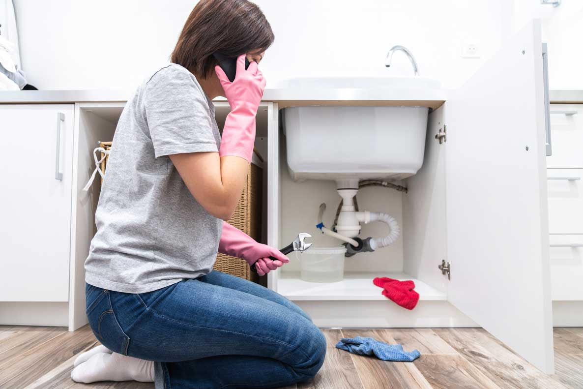 Woman-calling-carpet-cleaners-for-flooding-emergency
